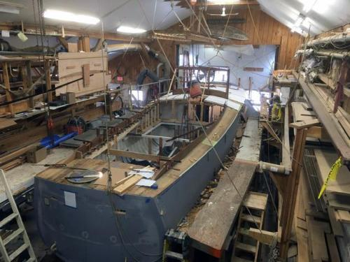 Double-planked teak decks finished, coamings fit, and forward pilot house frame fastened